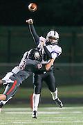 Cedar Ridge quarterback Daryl Lydon gets harrassed by Bowie's Zachary Velasquez Friday at Burger Stadium in Austin.  (LOURDES M SHOAF for Statesman.)