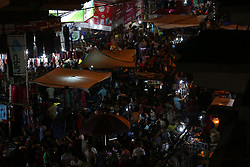 June 25, 2017 - Gaza City, Gaza Strip, Palestinian Territory - Palestinians shop at a market ahead of Eid al-Fitr holiday, in Gaza city on June 24, 2017. Eid al-Fitr marks the end of Muslim's holy fasting month of Ramadan when faithfuls abstain from eating, drinking, smoking and sexual activities from dawn to dusk  (Credit Image: © Mohammed Asad/APA Images via ZUMA Wire)