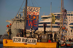 © Licensed to London News Pictures.  12/06/2021. Falmouth, UK. Extinction Rebellion activists gather around the cruise ship Silja Europa in Falmouth, Cornwall to send a message about the shipping industry; on the second day of the G7. Photo credit: Marcin Nowak/LNP