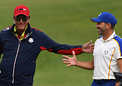 Team Europe's Sergio Garcia (right) and Team USA vice captain Phil Mickelson shake hands during day three of the 43rd Ryder Cup at Whistling Straits, Wisconsin. Picture date: Sunday September 26, 2021.