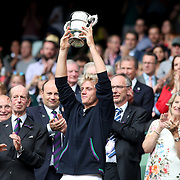 LONDON, ENGLAND - JULY 16: Alejandro Davidovich Fokina of Spain with his trophy after winning the Boy's Singles title during the Wimbledon Lawn Tennis Championships at the All England Lawn Tennis and Croquet Club at Wimbledon on July 16, 2017 in London, England. (Photo by Tim Clayton/Corbis via Getty Images)