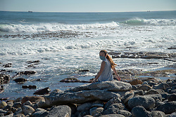 Rock artist Lara Thompson's daugther Shae, 12, enjoys the ocean view near Slangkop light house in Kommetjie, Cape Town, Thursday, July 17, 2020. As she often has seasonal allergies and other respiratory problems, she hasn't been back to school since lockdown started, her mother says. PHOTO: EVA-LOTTA JANSSON