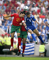 Fotball<br /> EURO 2004<br /> Portugal<br /> 12.06.2004<br /> NORWAY ONLY<br /> <br /> Hellas v Portugal<br /> <br /> Photo: Scott Heavey, Digitalsport.<br /> <br /> Fernando Couto of Portugal (L) out jumps Angelos Charisteas
