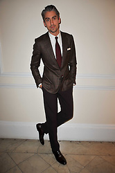 Presenter GEORGE LAMB at a photographic retrospective showcasing images from Guess's historic advertising campaigns held at Il Bottaccio, Grosvenor Place, London on 28th October 2009.