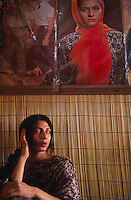 Pakistan - Hijra, les demi-femmes du Pakistan - Nazuk, 20 ans chez elle à Lahore. // Pakistan. Punjab province. Hijra, the half woman of Pakistan. During the festival of Holy Soufi Baba Masta Wali Sharkar, a hundred of Hijras assemble in the camps. Every day, they give procession to honor the tomb of the Holy Soufi and devote themselves in show.