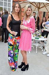 Left to right, business partners JEMIMA GOLDSMITH and LUCY CARR-ELLISON at The Ralph Lauren & Vogue Wimbledon Summer Cocktail Party at The Orangery, Kensington Palace, London on 22nd June 2015.  The event is to celebrate ten years of Ralph Lauren as official outfitter to the Championships, Wimbledon.