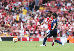 Reiss Nelson of Arsenal is pressed by Leo Dubois of Lyon - Mandatory by-line: Arron Gent/JMP - 28/07/2019 - FOOTBALL - Emirates Stadium - London, England - Arsenal v Olympique Lyonnais - Emirates Cup