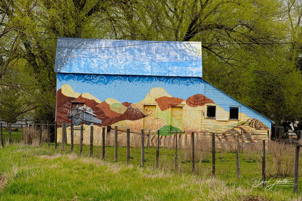 Palouse country barn painted with Palouse scenes, near Uniontown, Washington, USA