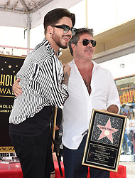 Simon Cowell receives a star on the Hollywood Walk of Fame. 22 Aug 2018 Pictured: Adam Lambert,Simon Cowell. Photo credit: AXELLE/BAUER-GRIFFIN / MEGA TheMegaAgency.com +1 888 505 6342