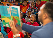 Former Houston Texan JJ Moses reads to students during a Touchdown Houston literacy program at NQ Henderson Elementary School, November 11, 2016.