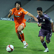 Istanbul BBSpor's Can ARAT (L) and Galatasaray's Arda TURAN (R) during their Turkish soccer superleague match Istanbul BBSpor between Galatasaray at the Ataturk Olympic stadium in Istanbul Turkey on Saturday 01 May 2010. Photo by TURKPIX