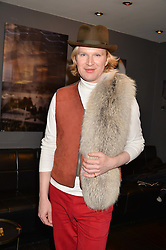 Henry Conway at an exhibition of photographs by Erica Bergsmeds held at The Den, 100 Wardour Street, London England. 19 January 2017.