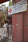 An outreach worker leaves an Operation Asha health clinic in Delhi, India. She is going out to do active-case finding which is aimed at discovering patients with symptoms of pulmonary Tuberculosis which a highly infectious and a big public health problem in India.