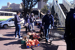 South Africa Cape Town 05 August 2020 Law Enforcement officers confisticating fruit and vegetables from 3 hawkers selling on the pavement in Strand street Cape Town. Photographer Ayanda Ndamane /African News Agency(ANA)