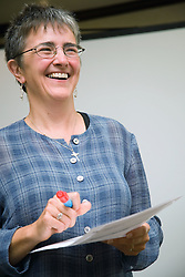 Portrait of trainer on youth justice staff training day smiling,