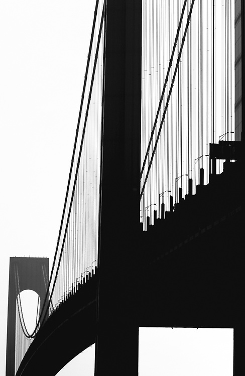 Silhouette of the Verrazano Narrows bridge taken from driving underneath. NYC 2010