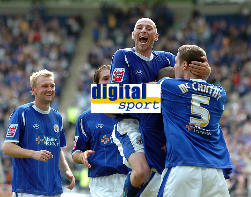 Photo: Kevin Poolman.<br />Leicester City v Southend United. Coca Cola Championship. 26/08/2006. Danny Tiatto jumps on Patrick Kisnorbo and Patrick McCarthy after Leicester's first goal.