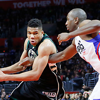 16 December 2015: Milwaukee Bucks forward Giannis Antetokounmpo (34) drives past Los Angeles Clippers forward Luc Richard Mbah a Moute (12) during the Los Angeles Clippers 103-90 victory over the Milwaukee Bucks, at the Staples Center, Los Angeles, California, USA.