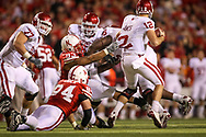 Ndamukong Suh tries to tackle Oklahoma quarterback Landry Jones during Nebraska's 10-3 win at Memorial Stadium in Lincoln, Neb. on Nov. 7, 2009. ©Aaron Babcock