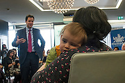 © Licensed to London News Pictures. 25/03/2015. London, UK. One year old Julian Foreman-Byrne with his mother Penny Foreman listens to Nick Clegg speak Deputy Prime Minister and leader of the Liberal Democrats Nick Clegg takes part in a Mumsnet question and answer session at 30 Eutson Square. Photo credit : Stephen Simpson/LNP