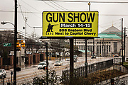 "Sign for gunshow on 3rd March 2020 in Montgomery, Alabama, United States. Montgomery County residents' now have constitutional right to bear arms. The Montgomery County Commissioners Court unanimously passed a resolution to make the county a gun sanctuary. The resolution was introduced by Commissioner Charlie Riley who said he wanted to take steps to protect citizens' guns after politicians like Democrat Beto O'Rourke said he'd take away people's guns and also called for a mandatory buyback of AK-47 and AR-15 assault rifles. It also says the county will not authorize or appropriate government funds or resources, ""for the purpose of enforcing or assisting in the enforcement of any element of such acts, laws, orders, mandates, rules or regulations, that infringe on the right by the people to keep and bear arms."