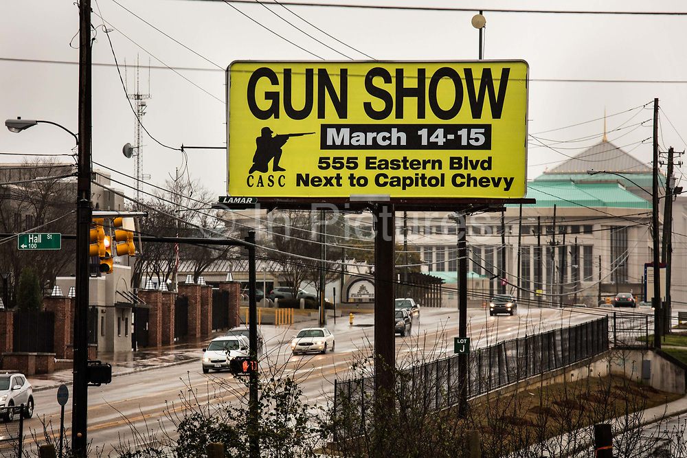 """Sign for gunshow on 3rd March 2020 in Montgomery, Alabama, United States. Montgomery County residents' now have constitutional right to bear arms. The Montgomery County Commissioners Court unanimously passed a resolution to make the county a gun sanctuary. The resolution was introduced by Commissioner Charlie Riley who said he wanted to take steps to protect citizens' guns after politicians like Democrat Beto O'Rourke said he'd take away people's guns and also called for a mandatory buyback of AK-47 and AR-15 assault rifles. It also says the county will not authorize or appropriate government funds or resources, """"for the purpose of enforcing or assisting in the enforcement of any element of such acts, laws, orders, mandates, rules or regulations, that infringe on the right by the people to keep and bear arms."""