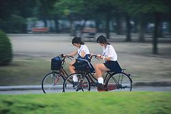 Girls Riding Bikes Through Peace Park