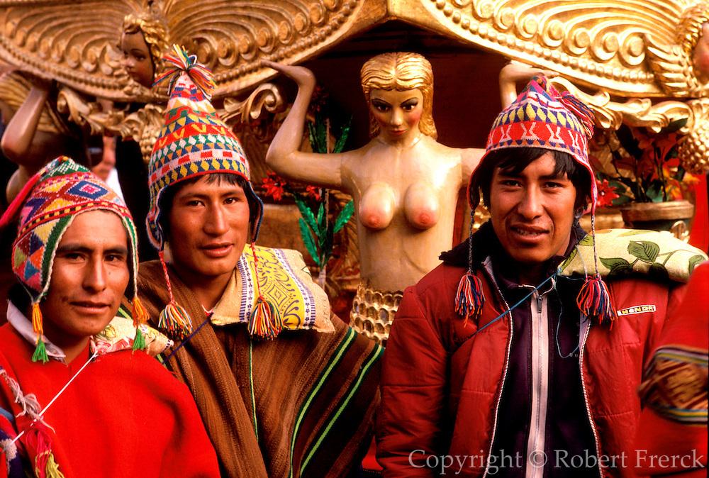 PERU, FESTIVALS Corpus Christi Festival in Cuzco; men  carrying a santo in procession around the Plaza de Armas,