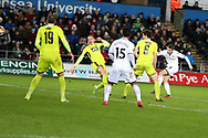 Tom Carroll of Swansea city (far right) shoots from range to score his teams 7th goal.  The Emirates FA Cup, 4th round replay match, Swansea city v Notts County at the Liberty Stadium in Swansea, South Wales on Tuesday 6th February 2018.<br /> pic by  Andrew Orchard, Andrew Orchard sports photography.