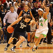 Kelly Faris, Connecticut, drives past Skylar Diggins, Notre Dame, (right), during the Connecticut V Notre Dame Final match won by Notre Dame during the Big East Conference, 2013 Women's Basketball Championships at the XL Center, Hartford, Connecticut, USA. 11th March. Photo Tim Clayton