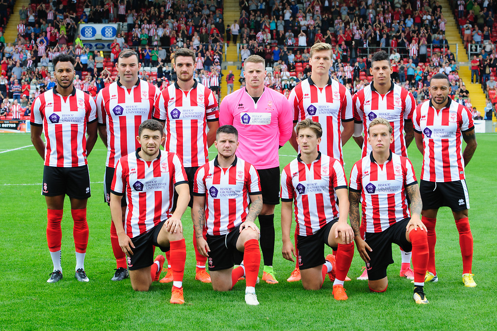 Lincoln City players prior to the pre-season friendly with Peterborough United.  Back row, from left, Matt Green, Matt Rhead, Luke Waterfall, Paul Farman, Sean Raggett, Matthew Briggs and Nathan Arnold.  Front row, from left, Sean Long, Billy Knott, Alex Woodyard and Jordan Maguire-Drew<br /> <br /> Photographer Chris Vaughan/CameraSport<br /> <br /> Football - Pre-Season Friendly - Lincoln City v Peterborough United - Saturday 22nd July 2017 - Sincil Bank - Lincoln<br /> <br /> World Copyright © 2017 CameraSport. All rights reserved. 43 Linden Ave. Countesthorpe. Leicester. England. LE8 5PG - Tel: +44 (0) 116 277 4147 - admin@camerasport.com - www.camerasport.com