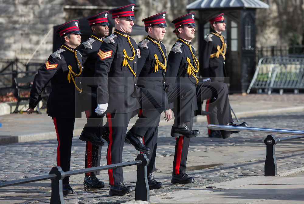 © Licensed to London News Pictures. 14/11/2013. London, UK. Members of the Honourable Artillery Company (HAC) march before they fire a 62 gun salute at Tower Wharf outside the Tower of London to mark Prince Charles birthday today. Photo credit : Vickie Flores/LNP