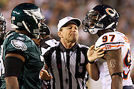 PHILADELPHIA - OCTOBER 21: Defensive End Mark Anderson of the Chicago Bears is seprated by the ref from Tackle Shawn Andrews of the Philadelphia Eagles  during the game against the Chicago Bears on October 21, 2007 at Lincoln Financial Field in Philadelphia, Pennsylvania. The Bears won 19-16.