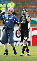 Photo: Paul Greenwood/Richard Lane Photography. <br />Burnley v Cardiff City. Coca-Cola Championship. 26/04/2008. <br />Cardiff Physio Sean Connolly, (L) helps the injured Stephen McPhail from the field.