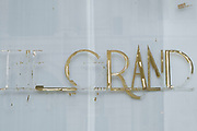 Old sign which has been scraped off for the The Grand Cafe by Concerto in Mayfair on 5th March 2021 in London, England, United Kingdom. This art deco landmark on Piccadilly is now listed as permanently closed.