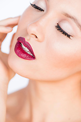 Close up of Young Woman's Face with Dark red Lips