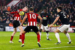 Oliver McBurnie of Sheffield United controls the ball just before scoring a goal to make it 3-3 which is reviewed by VAR - Mandatory by-line: Robbie Stephenson/JMP - 24/11/2019 - FOOTBALL - Bramall Lane - Sheffield, England - Sheffield United v Manchester United - Premier League