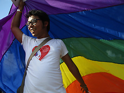 June 24, 2017 - Manila, Philippines - A participant holds a rainbow flag over his head as shade during the annual LGBT (lesbian, gay, bisexual, and transgender) Pride Parade in Marikina City, east of Manila, Philippines on Saturday, June 24, 2017. Thousands of members and supporters of the Lesbian, Gay, Bisexual, and Transgender (LGBT) community marched in the 21st year of the oldest pride march in Southeast Asia, as they called on for the passage of anti-discrimination laws protecting the LGBT community, as well as for the legalization of same-sex marriage in the predominantly Catholic country. (Credit Image: © Richard James Mendoza/NurPhoto via ZUMA Press)