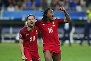 Portugal Midfielder Adrien Silva and Portugal Midfielder Renato Sanches celebrate during the Euro 2016 final between Portugal and France at Stade de France, Saint-Denis, Paris, France on 10 July 2016. Photo by Phil Duncan.