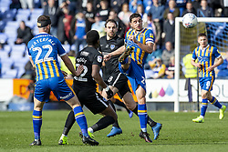March 23, 2019 - Meadow, Shropshire, United Kingdom - Oliver Norburn of Shrewsbury Town passes out wide under pressure from Omar Bogle of Portsmouth FC during the Sky Bet League 1 match between Shrewsbury Town and Portsmouth at Greenhous Meadow, Shrewsbury on Saturday 23rd March 2019. (Credit Image: © Mi News/NurPhoto via ZUMA Press)