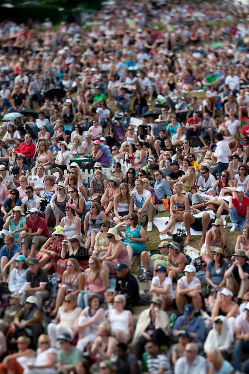 Mcc0032212 . Daily Telegraph..Crowds on Henman Hill watching the Mens Final .Rafael Nadal vs Novak Djokovic in the Mens Singles Finals...The thirteenth and final day of The Lawn Tennis Championships at Wimbledon..London 3 July 2011