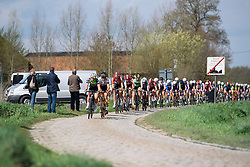 The peloton approach across the cobbles - Grand Prix de Dottignies 2016. A 117km road race starting and finishing in Dottignies, Belgium on April 4th 2016.