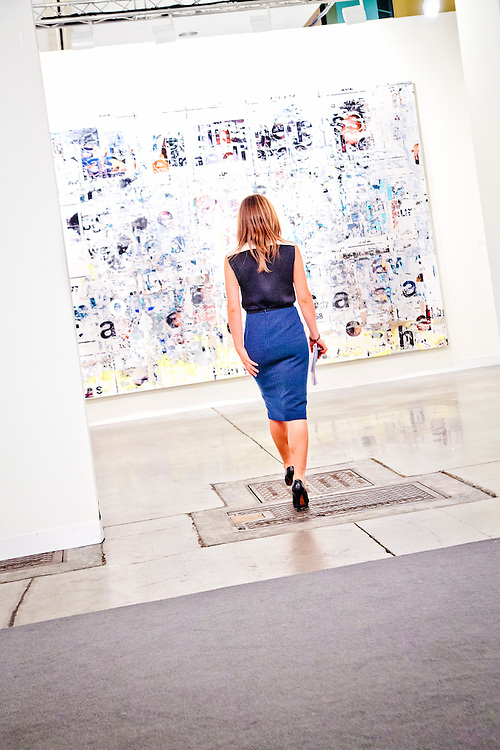 Woman and large painting at Art Basel Miami Beach 2011