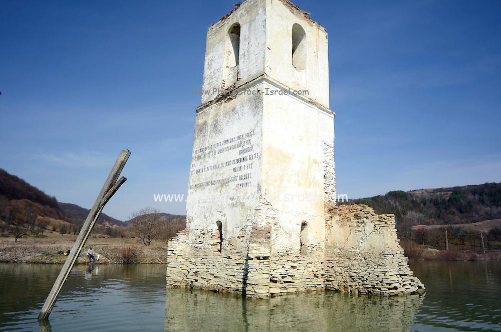 The church of the flooded Bezidu Nou (Bözödújfalu) village