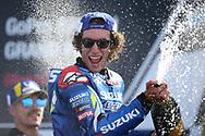 MotoGP race winner #42 Alex Rins, Spanish: Team Suzuki Ecstar sprays the victory champagne  during the GoPro British MotoGP at Silverstone, Towcester, United Kingdom on 25 August 2019.