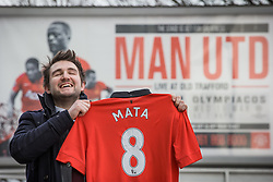 © Licensed to London News Pictures . 27/01/2014 . Manchester , UK . ANDY LEATHLEY (28) from Chorlton poses with his new shirt in front of an ad board in front of Old Trafford . Fans with new MATA 8 shirts in front of Old Trafford Football Ground as it's announced that Spaniard Juan Mata ( Juan Manuel Mata García ) has signed for Manchester United  . Photo credit : Joel Goodman/LNP