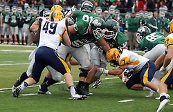 18 October 2014:  Donovan Laible looks for short conversion yardage in the middle during an NCAA division 3 football game between the Augustana Vikings and the Illinois Wesleyan Titans in Tucci Stadium on Wilder Field, Bloomington IL