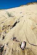 Litter left on huge sand dune at Long Nook Beach, Cape Cod National Seashore, Truro, Cape Cod, Massachusetts, USA