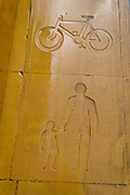 A detail view of a stencil depicting a bike and pedstrians on a shared multicoloured pedestrianised traffic-free thoroughfare in the City of London, capital's financial district, aka The Square Mile, on 20th October 2021, in London, England.