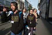 Chinese family with Star Wars sweatshirts out on Oxford Street which is the busiest shopping district in London, England, United Kingdom.